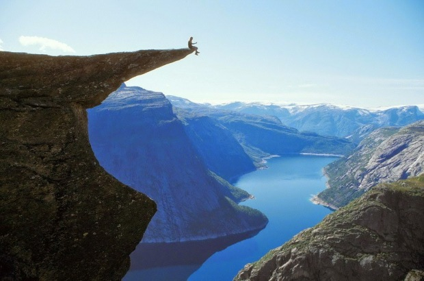 person-sitting-on-cliff